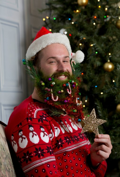 "London based artist Katya Wildman has given beards a seasonal makeover to mark the launch of the new Samsung Galaxy Note Edge handset. The festive fashion project took six hours to complete and feature seasonal staples including a Christmas tree, robin red breast, mistletoe, glitter, snow and icicles. Katya commented, ""I have always been fascinated by facial hair – and now I have the chance to try out my festive designs on some bounteous beards. I used the Galaxy Note Edge to photograph the models and create a series of portraits that I hope will raise a smile this festive season!"" Pix:Tim Anderson FREE PHOTO USAGE"
