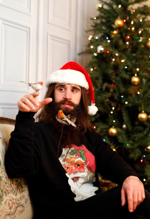 EDITORIAL USE ONLY Daniel Hayes sports a beard with a 'festive edge' to mark the launch of the new Samsung Galaxy Note Edge handset. PRESS ASSOCIATION Photo. Issue date: Thursday December 11, 2014. Artist Katya Wildman spent six hours creating the Christmas Beard designs which feature an upside down Xmas tree, a robin red breast, mistletoe and icicles. Photo credit should read: David Parry/PA